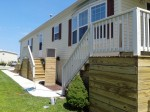 Millsboro, DE– After deck cleaning, rails were stained with solid stain, 2 coats