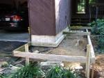 Floating walkway temporarily supported above concrete footers – by DeckResurrect