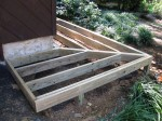 "Floating walkway supported on 8"" concrete footers with double rims prior to decking – by DeckResurrect"