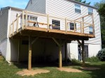 Final stages of custom deck with railing by DeckResurrect