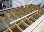 Blocking added to keep floor joist straight – by Deck Resurrect