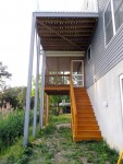 Elevated deck columns & screened-in porch stained– Greenbackville, VA (Facing Wallops Island)