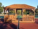 After cleaning, wood components replaced, gazebo stained with premium semi solid stain. Easton, MD.