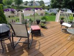 Deck with heavy stain needs cleaning and recoating, Oceanview, DE